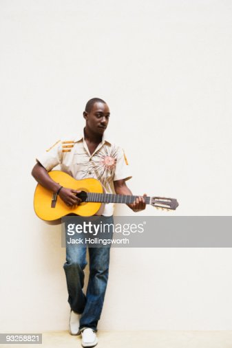 African man playing guitar