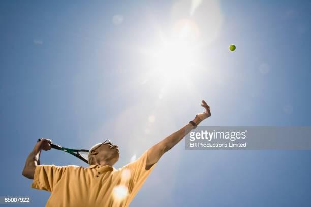 African man playing tennis