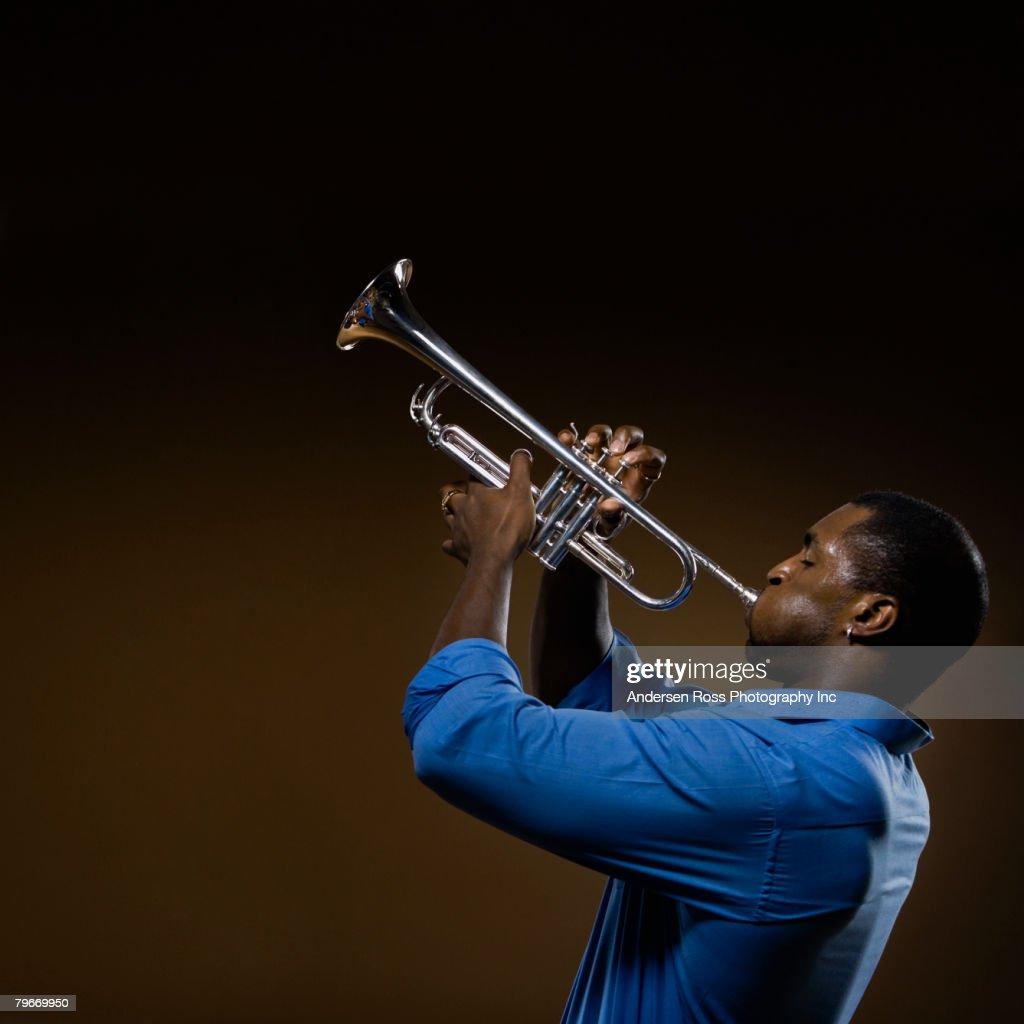 African man playing trumpet