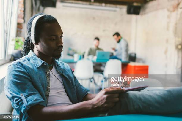 African man podcasting