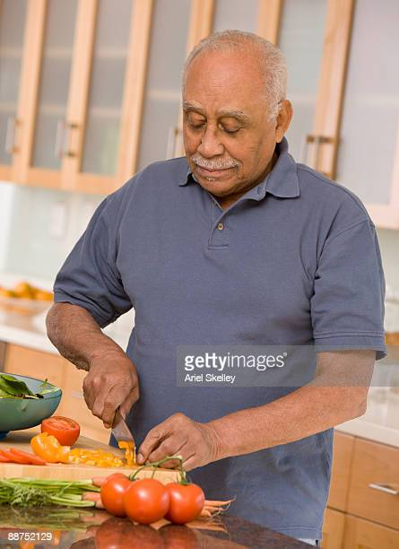 African man preparing healthy meal