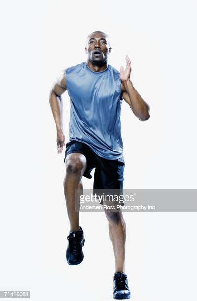 African man running in place
