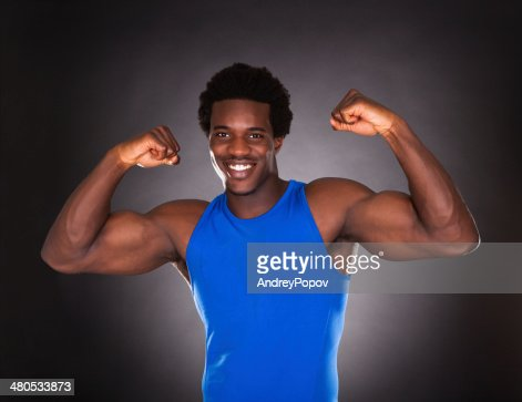 African Man Showing Muscle : Stock Photo