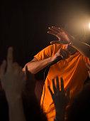 African man singing to audience