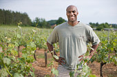 African man standing in vineyard
