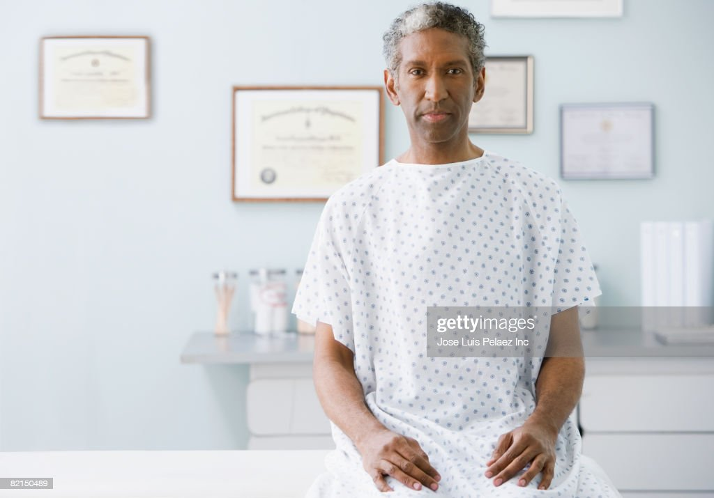 African man wearing hospital gown : Stock Photo