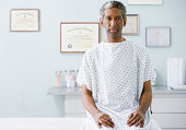 African man wearing hospital gown