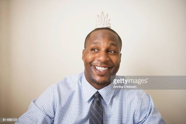 African man wearing tiara