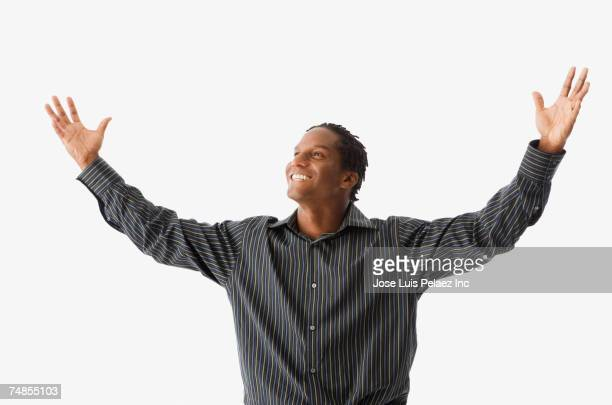 African man with arms outstretched