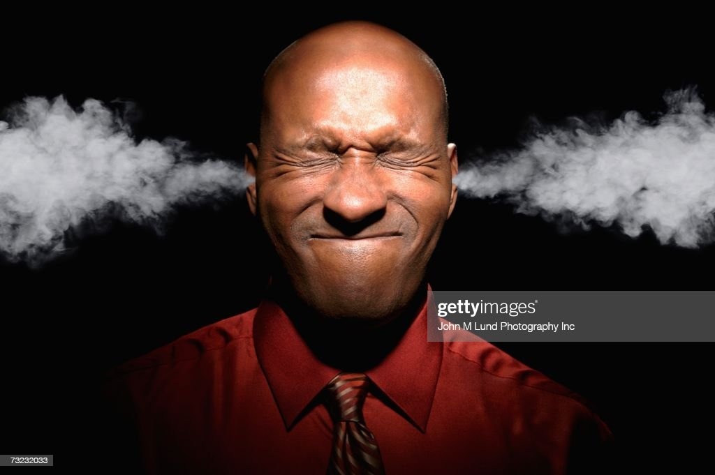 African man with eyes closed and steam coming from ears : Stock Photo