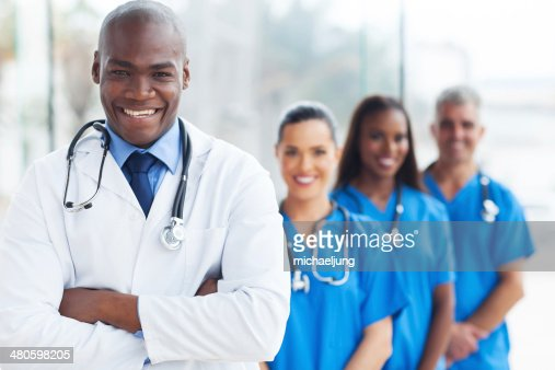 african medical doctor and colleagues in hospital : Stock Photo