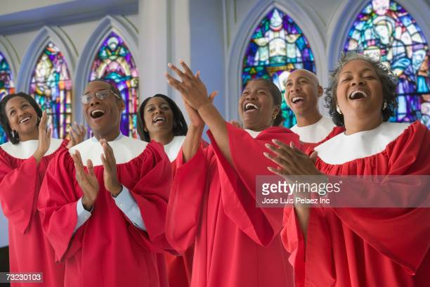 African men and women in church choir singing