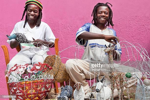 African men designing and producing beadwork