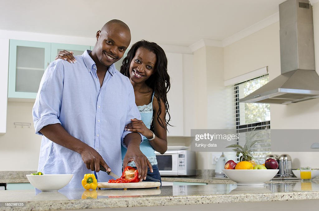 African middle class couple in the kitchen stock photo for African kitchen