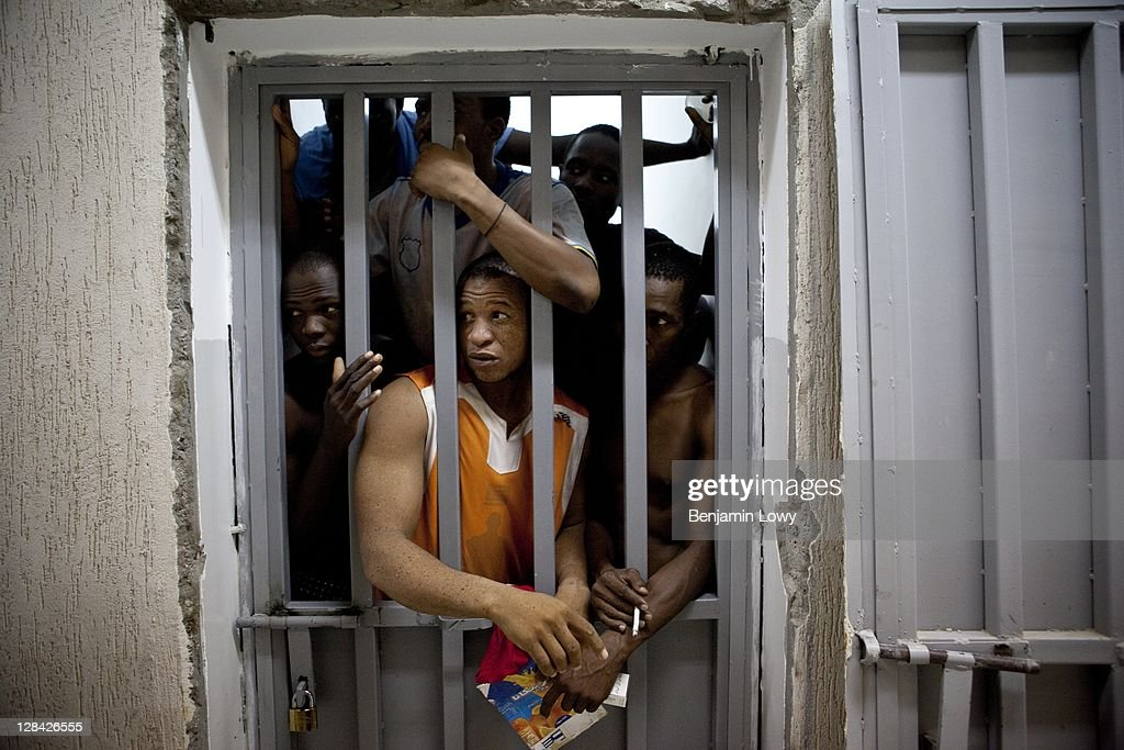 African migrant workers accused of being mercenaries for former Libyan Dictator Moammar Gaddafi are kept in a small low-security prison on September 1 2011 in Tripoli, Libya. While Gaddafi did use a number of paid African soldiers to battle the rebels, most Africans are simply arrested and harrassed in libya for simply being black.