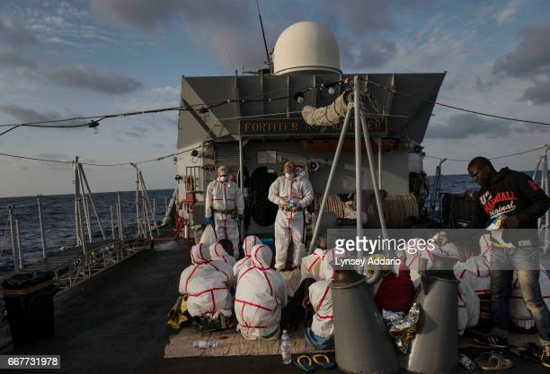 African migrants from Mali Senegal Ivory Coast and Nigeria who were rescued by a commercial ship and then transferred to the Uraniam Navy Ship are...