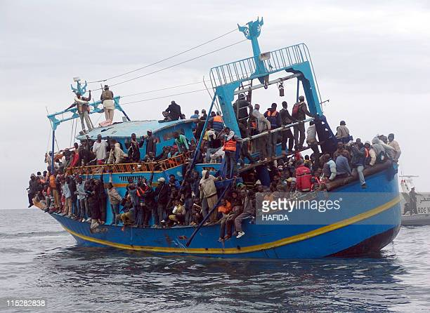 African migrants stranded on a boat coming from Libya wait for rescue services near Sfax on the Tunisian coast on June 4 2011 Between 200 and 270...