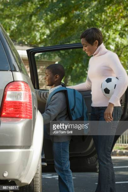 African mother and son leaving for soccer practice