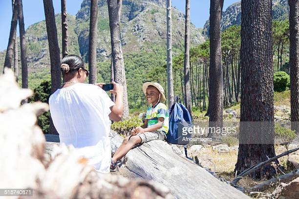 African mother taking a picture of her son