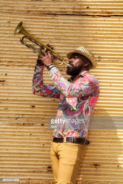 African musician playing trumpet