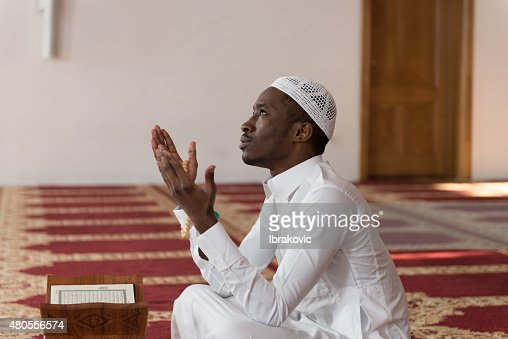 African Muslim Man Is Praying In The Mosque : Stock Photo
