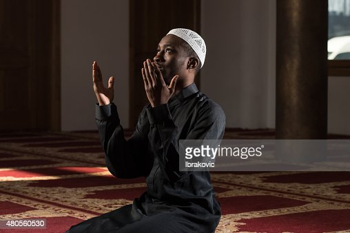 African Muslim Man Praying At Mosque : Stock Photo