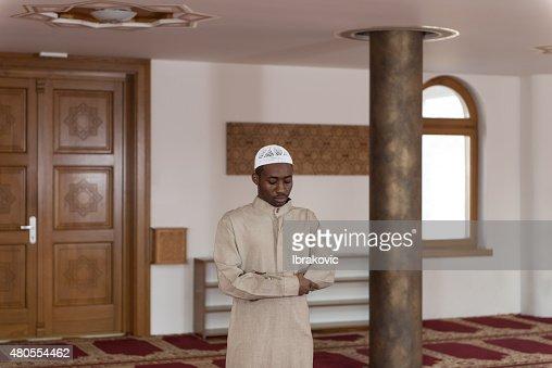 African Muslim Praying In Mosque : Stock Photo