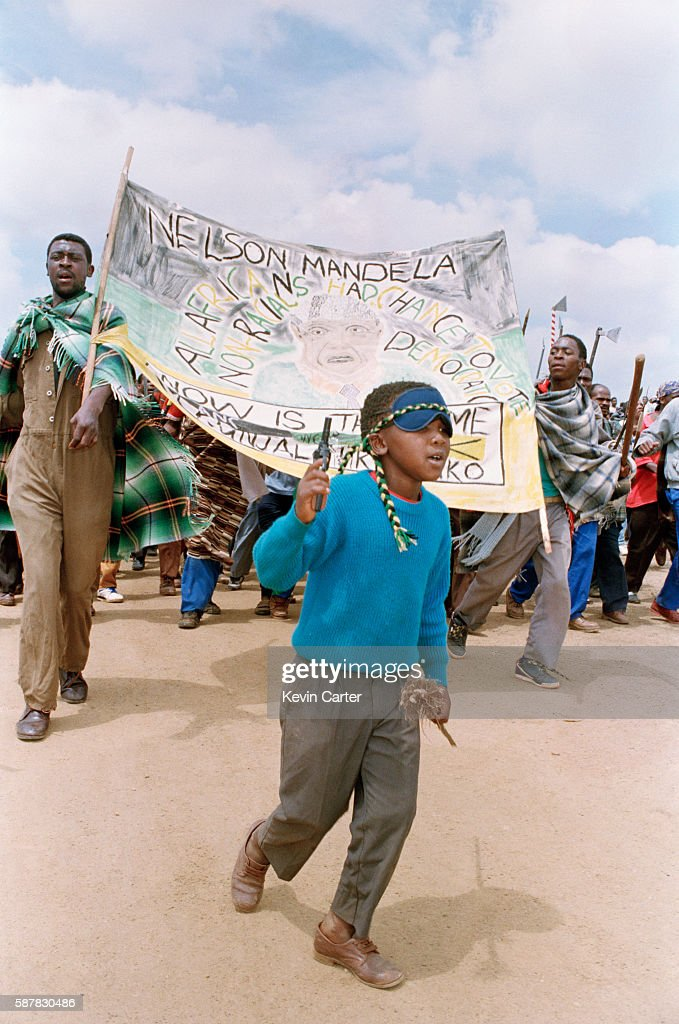 African National Congress demonstration during the campaign for the 1994 general election A young boy leads a local selfdefense unit to Ivory Park
