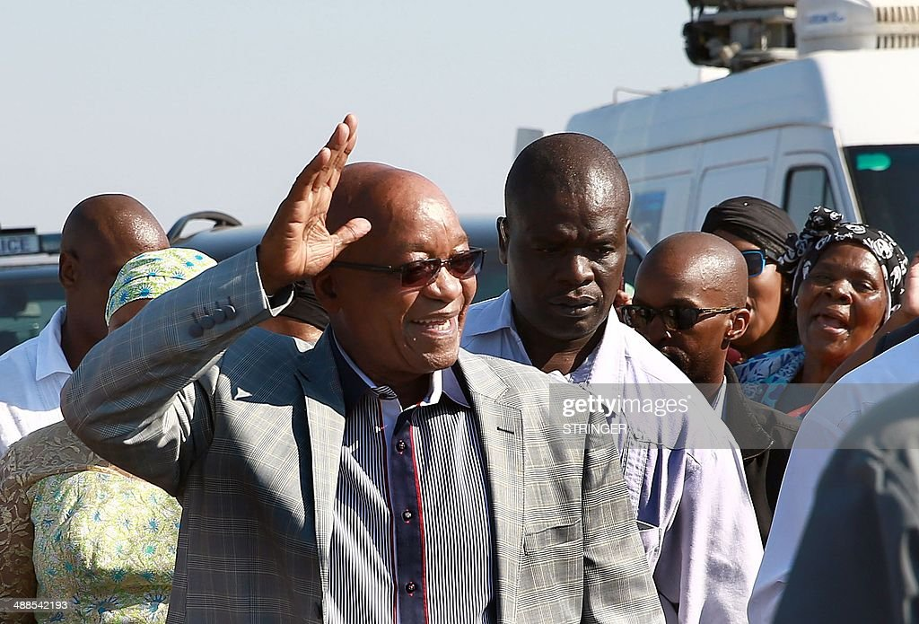 African National Congress leader Jacob Zuma waves at supporters after casting his vote for the general elections at the Ntolwane Primary School in...