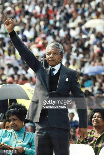 African National Congress leader Nelson Mandela rises his right fist during a rally in Soweto on February 13 1990 in Johannesburg South Africa