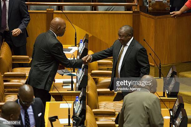 African National Congress Member of the National Assembly of South Africa Stone Sizani and Deputy President of South Africa Cyril Ramaphosa shake...