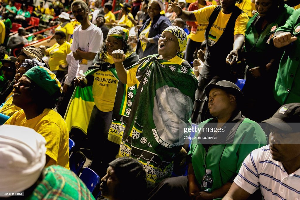 African National Congress members sing and dance during a prayer meeting at the Standard Bank Arena during a national day of prayer for former President Nelson Mandela December 8, 2013 in Johannesburg, South Africa. Mandela, also known as Madiba, passed away on the evening of December 5th, 2013 at his home in Houghton at the age of 95. Mandela became South Africa's first black president in 1994 after spending 27 years in jail for his activism against apartheid in a racially-divided South Africa.