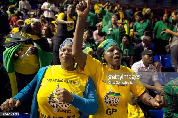 African National Congress members sing and dance during a prayer meeting at the Standard Bank Arena during a national day of prayer for former...