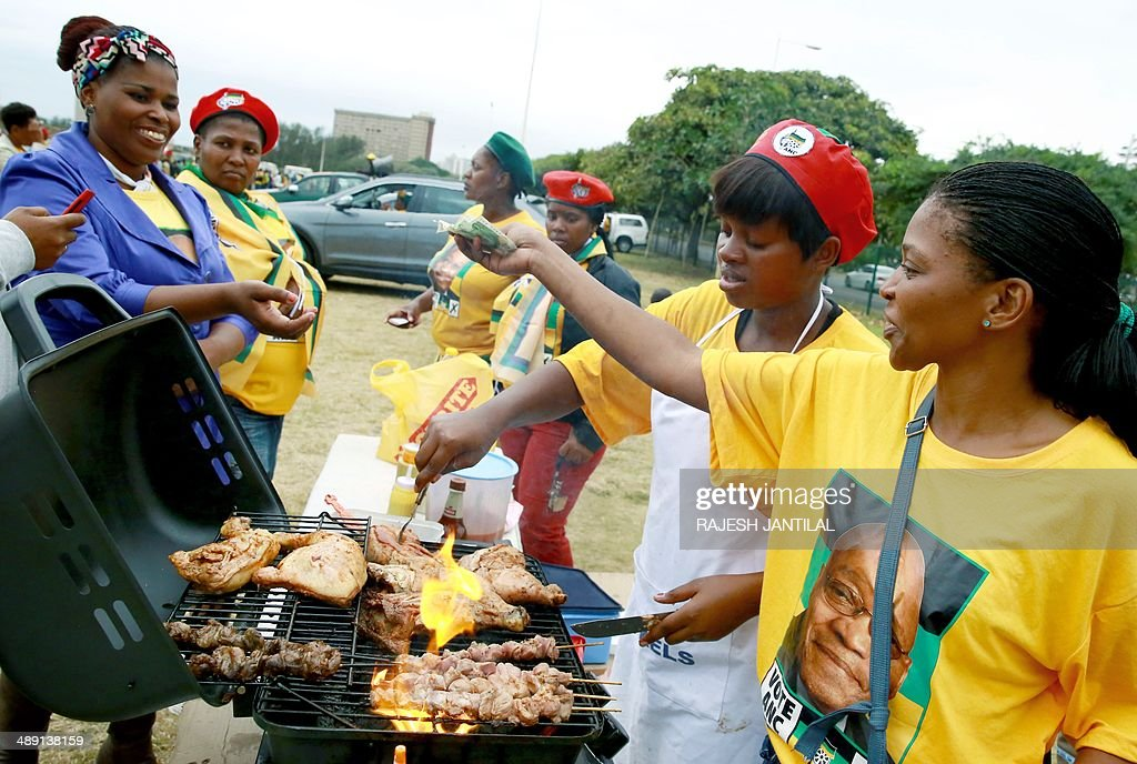 African National Congress (ANC) supporters buy food during the victory celebrations of the ANC at the Peoples Park outside the Moses Mabhida Football stadium in Durban on May 10, 2014. Completed results showed the African National Congress won 62.15 percent of the ballots, while the main opposition Democratic Alliance came in second with 22.23 percent. AFP/ PHOTO