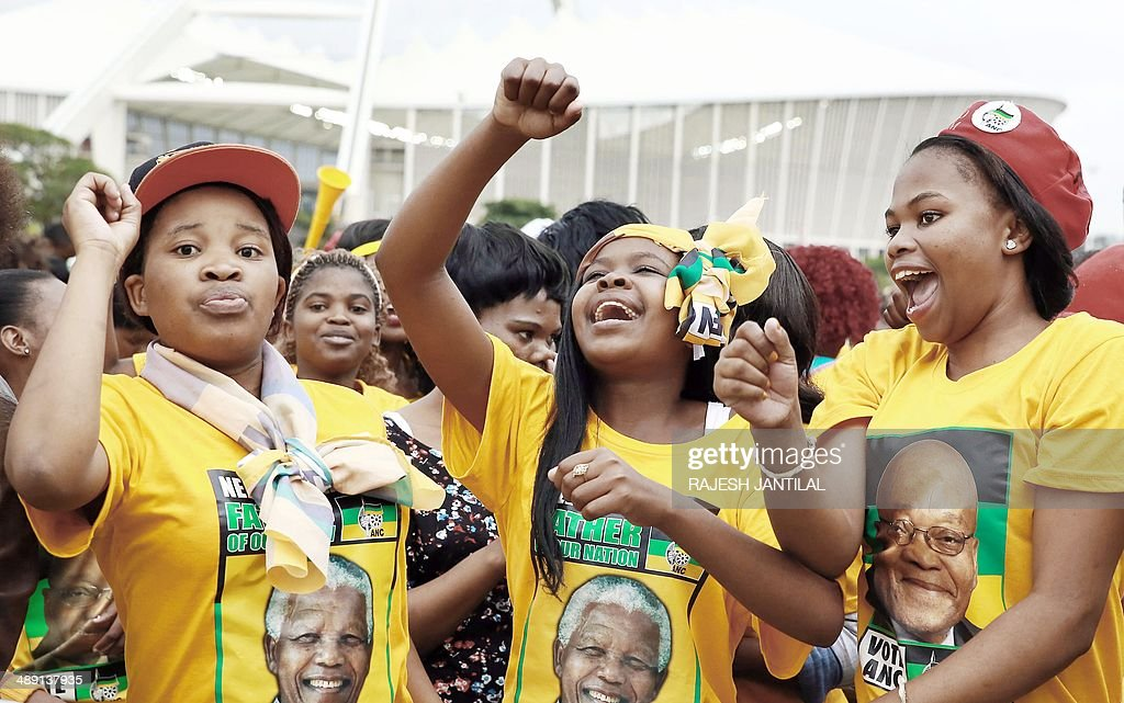 African National Congress (ANC) supporters celebrate during the victory celebrations of the ANC at the Peoples Park outside the Moses Mabhida Football stadium in Durban on May 10, 2014. Completed results showed the African National Congress won 62.15 percent of the ballots, while the main opposition Democratic Alliance came in second with 22.23 percent. AFP/ PHOTO