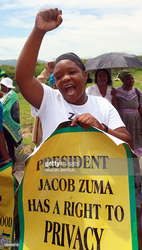 African National Congress (ANC) supporters gather outside President Jacob Zuma's private rural residence, preventing opposition leader Hellen Zille to visit him, at the centre of a row over a $29-million state-funded upgrade in Nkandla some 178 kilometres north of Durban on November 4, 2012. Police cited safety reasons for denying Zille and her six-member delegation passage to Zuma's homestead, where they wanted to inspect how public money was used to fund the president's private property.