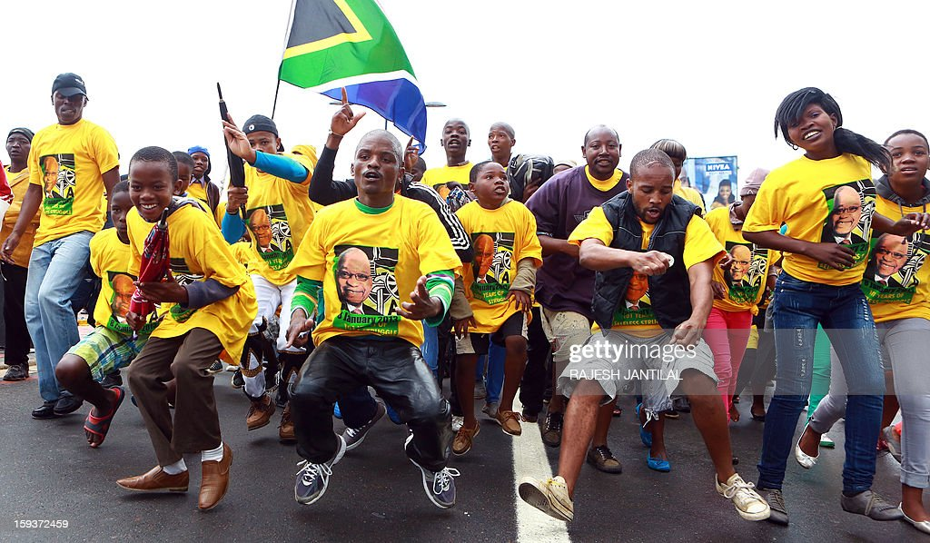 African National Congress (ANC) supporters peform a 'toyi toyi' dance during a event commemorating the 101st birthday of the ANC party in Durban on January 12, 2013. Close to 50 000 ANC supporters attend the massive rally to listen South Africa's President and ANC leader Jacob Zuma delivering the January 8th statement on behalf of the ANC.