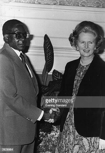 African nationalist and Zimbabe's first prime minister Robert Gabriel Mugabe meeting British prime minister Margaret Thatcher at No 10 Downing Street...