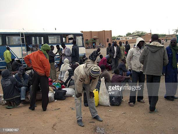 African nationals mainly Nigerians wait at a bus depot in Agadez on March 22 2011 after feeing conflict in Libya More than 10700 west Africans have...