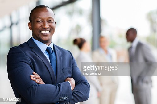 african office worker with arms crossed : Stock Photo