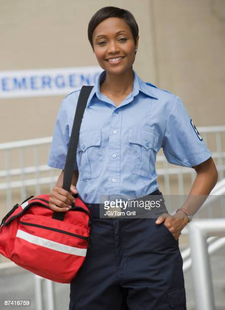 African paramedic holding first-aid kit