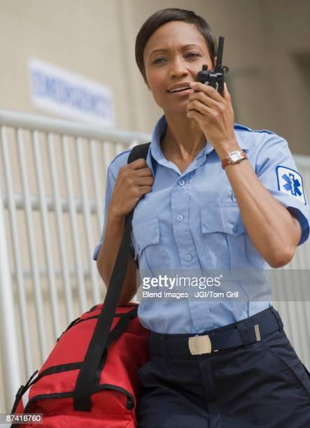 African paramedic talking on walkie talkie