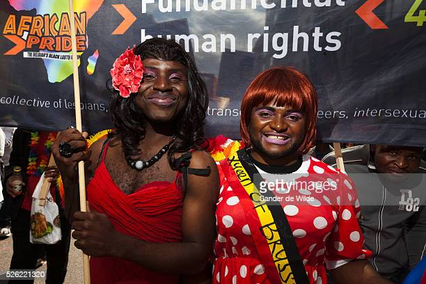 African participants of a gay pride parade in Brussels dressed up as females for african pride