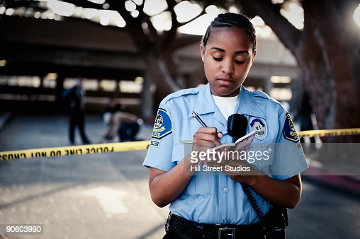 African policewoman writing in notebook