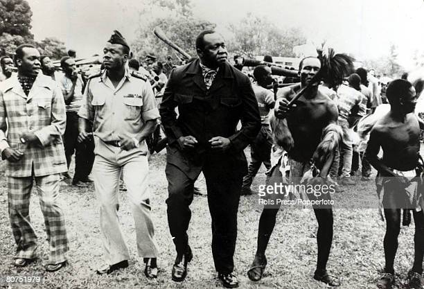 26th January 1977 President Idi Amin of Uganda centre pictured dancing during celebrations in Kampala to mark the start of his 7th year as President