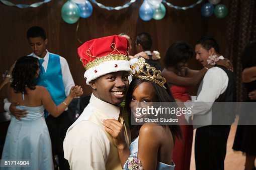 African prom king and queen dancing