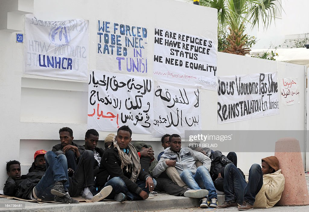 African refugees camp outside the headquarters of the High Commissioner for Refugees (UNHCR) on March 27, 2013 in Tunis to demand their resettlement outside Tunisia.