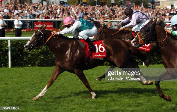 African Rose ridden by Stephane Pasquier goes on to win the Ladbrokes Sprint Cup during the Ladbrokes St Leger Day at Doncaster Racecourse