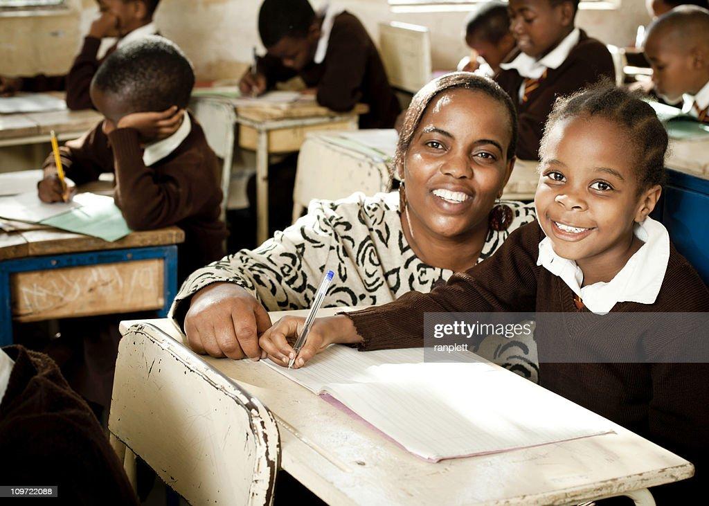 African Schoolgirl and her Teacher : Stock Photo