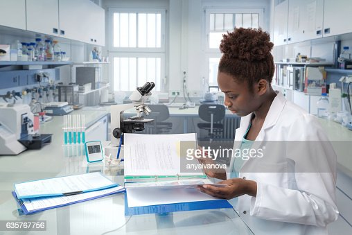 African scientist, medical worker or tech in modern laboratory : Stock-Foto